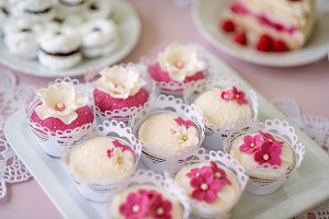 Close up, cupcakes on tray decorated with pink flowers