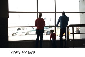 Young family watching planes