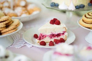 Close up, raspberry cake, cookies, horn pastry. Studio shot.