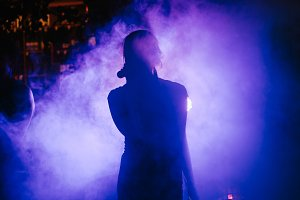 silhouette of the singer at a concert, wedding