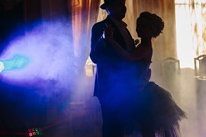 silhouette of dancers at a concert, wedding