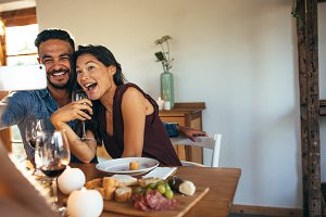 Couple taking selfie at dinner party