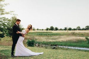 Beautiful bride and groom in a park