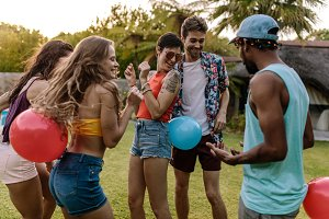 Group of friends playing balloon