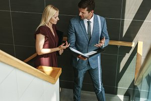 Businessman talking with female