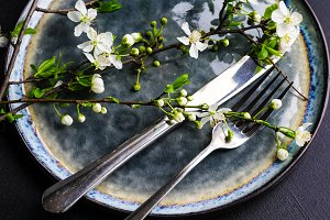 Spring table set with cherry flower