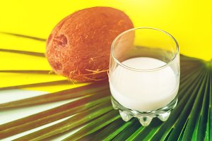 coconut and milk. a glass with cocon