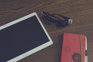 Tablet, notebook and sunglasses