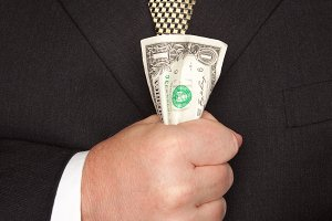 Businessman in Suit, Tie Holds Cash