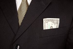 US Dollar in Business Suit Pocket