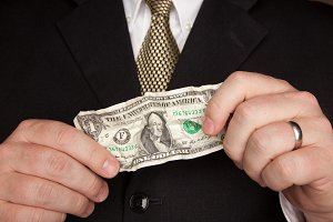 Businessman in Suit Tie Holds Dollar