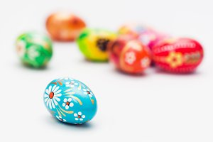 Handmade Easter eggs on white