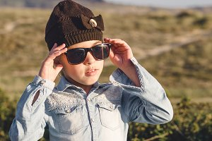 Little girl with sunglasses outdoors
