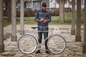 Hipster man with a fixie bike