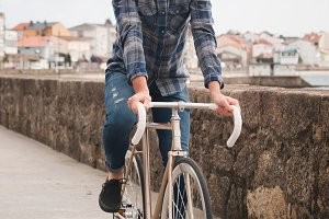 Hipster man riding on a fixie bike