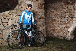 Cyclist posing with his racing bike