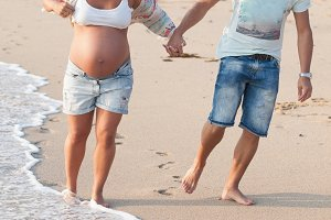 Happy Pregnant couple on beach