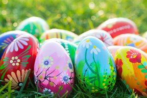 Hand painted Easter eggs on grass