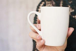 Women Hand Holding White Mug