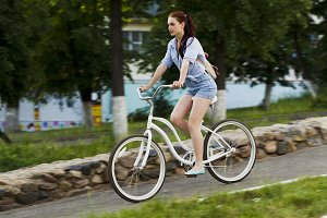 Girl and white bicycle