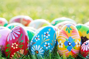 Hand-painted Easter eggs on grass