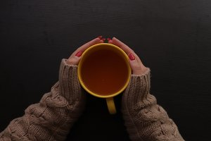 Girl holding a cup of hot tea