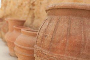 many large clay pots