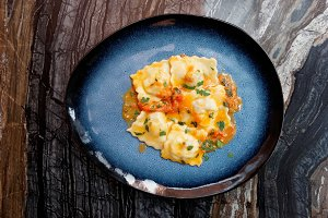 Ravioli in dark blue plate
