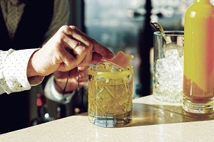 Mixologist is decorating a drink