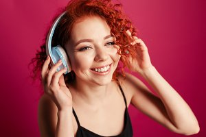 redhead girl with earphones