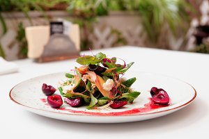 Light salad with cheese and cherries
