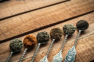 Spices and herbs in tea spoons