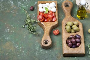 snacks: olives, mozzarella and tomatoes