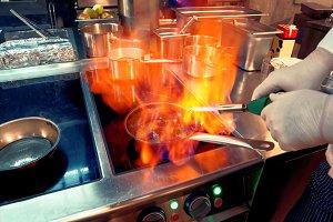 Chef making flambe igniting cognac