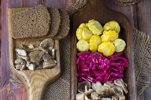 assorted pickled vegetables on wooden background