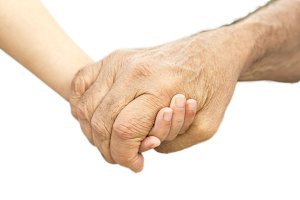 Hands of a grandfather and grandson