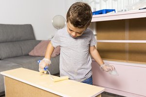 Kid painting a desk