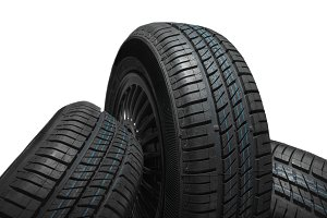 New and unused car tires against isolated background