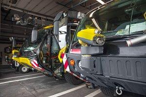 Modern firetrucks lined up in garage