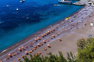 Beautiful view from above on the beach and people relaxing on the seaside - vacation and travel background.