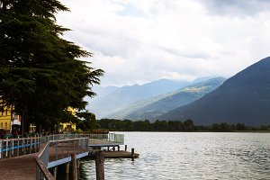 Beautiful embankment overlooking the mountains. Lovere, Lake Iseo, Italy.