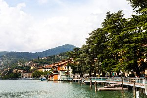 Beautiful embankment overlooking the mountains. Lake Iseo, Italy - architecture and travel background.