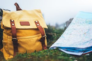 Yellow backpack and map