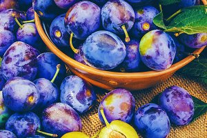 Plums on a wooden background.