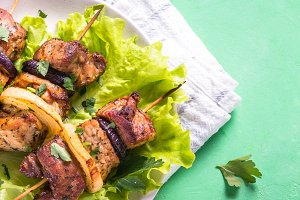 Grilled shish kebab or shashlik on green table.