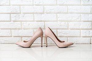 Beige high heels isolated