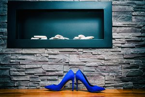 A pair of blue heels shoes