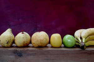 Yellow fruits row and green apple