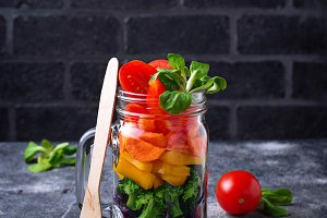 Vegetarian rainbow salad in a glass jar