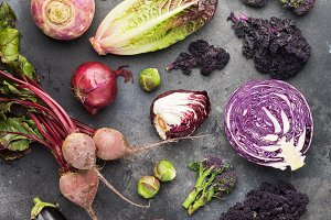 Vegetables background in purple, green and dark red